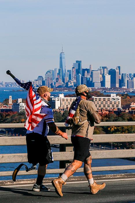 <div class='meta'><div class='origin-logo' data-origin='AP'></div><span class='caption-text' data-credit='(AP Photo/Eduardo Munoz Alvarez)'>With the One World Trade center in the background, runners cross the Verrazano-Narrows Bridge during the New York City Marathon on Sunday, Nov. 4, 2018, in New York.</span></div>