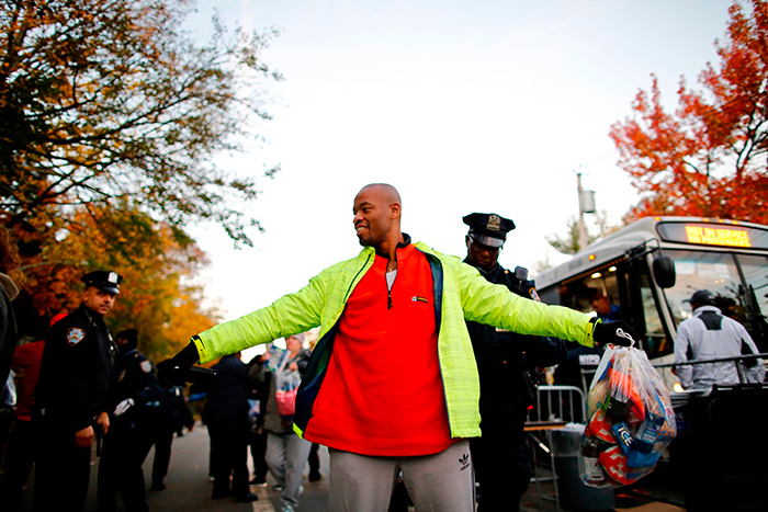 """<div class=""""meta image-caption""""><div class=""""origin-logo origin-image ap""""><span>AP</span></div><span class=""""caption-text"""">Runners are checked by NYPD officers as they arrive at he entrance near the Verrazano-Narrows Bridge before the New York City Marathon on Sunday, Nov. 4, 2018, in New York. (AP Photo/Eduardo Munoz Alvarez))</span></div>"""