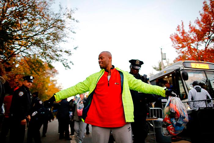<div class='meta'><div class='origin-logo' data-origin='AP'></div><span class='caption-text' data-credit='AP Photo/Eduardo Munoz Alvarez)'>Runners are checked by NYPD officers as they arrive at he entrance near the Verrazano-Narrows Bridge before the New York City Marathon on Sunday, Nov. 4, 2018, in New York.</span></div>
