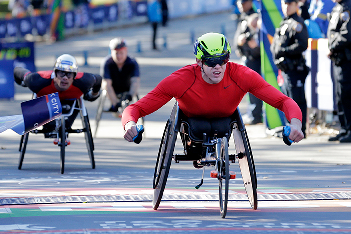 """<div class=""""meta image-caption""""><div class=""""origin-logo origin-image ap""""><span>AP</span></div><span class=""""caption-text"""">Daniel Romanchuk, of the United States, crosses the finish line first in the men's wheelchair division of the New York City Marathon in New York, Sunday, Nov. 4, 2018. ((AP Photo/Seth Wenig))</span></div>"""