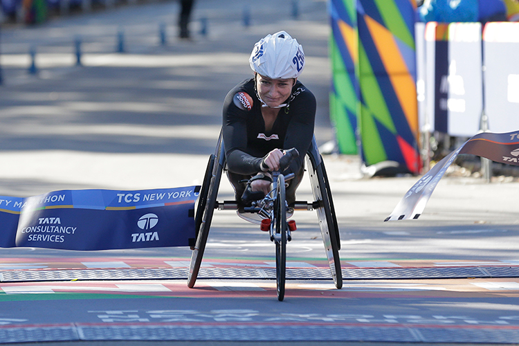 """<div class=""""meta image-caption""""><div class=""""origin-logo origin-image ap""""><span>AP</span></div><span class=""""caption-text"""">Manuela Schär of Switzerland crosses the finish line first in the women's wheelchair division of the New York City Marathon in New York, Sunday, Nov. 4, 2018. ((AP Photo/Seth Wenig))</span></div>"""