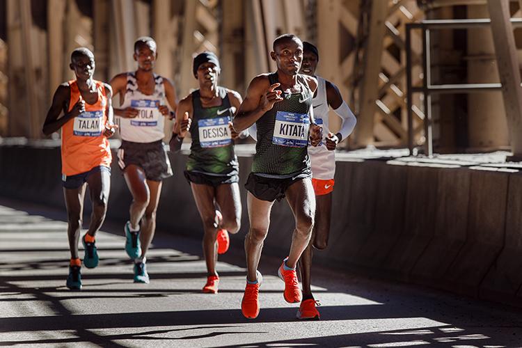 <div class='meta'><div class='origin-logo' data-origin='AP'></div><span class='caption-text' data-credit='AP Photo/Andres Kudacki)'>Tola Shura Kitata of Ethiopia, front, runs with the men's pack as they cross the Queensboro bridge during the New York City Marathon in New York, Sunday, Nov. 4, 2018.</span></div>