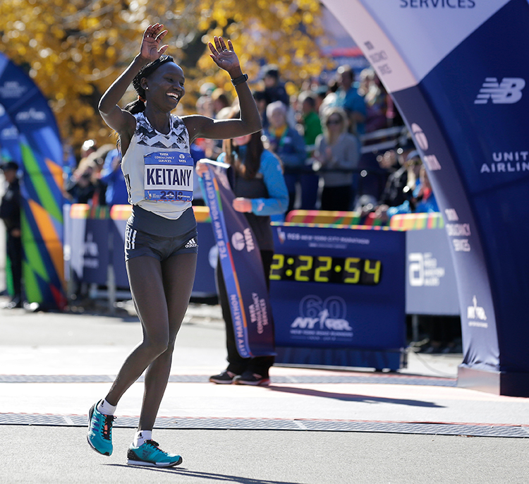 <div class='meta'><div class='origin-logo' data-origin='AP'></div><span class='caption-text' data-credit='(AP Photo/Seth Wenig)'>Mary Keitany of Kenya celebrates after crossing the finish line first in the women's division of the New York City Marathon in New York, Sunday, Nov. 4, 2018.</span></div>