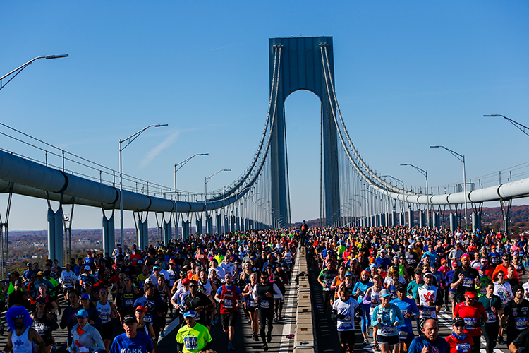 <div class='meta'><div class='origin-logo' data-origin='AP'></div><span class='caption-text' data-credit='(AP Photo/Eduardo Munoz Alvarez)'>Runners as they cross the Verrazano-Narrows Bridge during the New York City Marathon on Sunday, Nov. 4, 2018, in New York.</span></div>