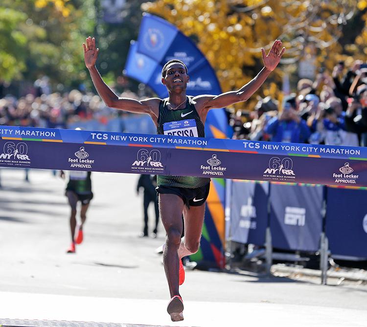 <div class='meta'><div class='origin-logo' data-origin='AP'></div><span class='caption-text' data-credit='(AP Photo/Seth Wenig)'>Lelisa Desisa, of Ethiopia, crosses the finish line first in the men's division of the New York City Marathon in New York, Sunday, Nov. 4, 2018.</span></div>