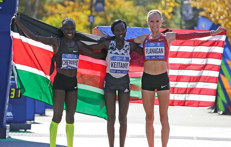 """<div class=""""meta image-caption""""><div class=""""origin-logo origin-image none""""><span>none</span></div><span class=""""caption-text"""">Second place finisher Vivian Cheruiyot of Kenya, left, first place finisher Mary Keitany of Kenya, center, and third place finisher Shalane Flanagan of the United States. ((AP Photo/Seth Wenig))</span></div>"""