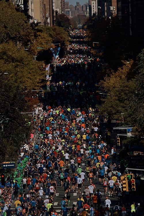 "<div class=""meta image-caption""><div class=""origin-logo origin-image ap""><span>AP</span></div><span class=""caption-text"">Runners move along First Avenue during the New York City Marathon in New York, Sunday, Nov. 4, 2018. ((AP Photo/Andres Kudacki))</span></div>"