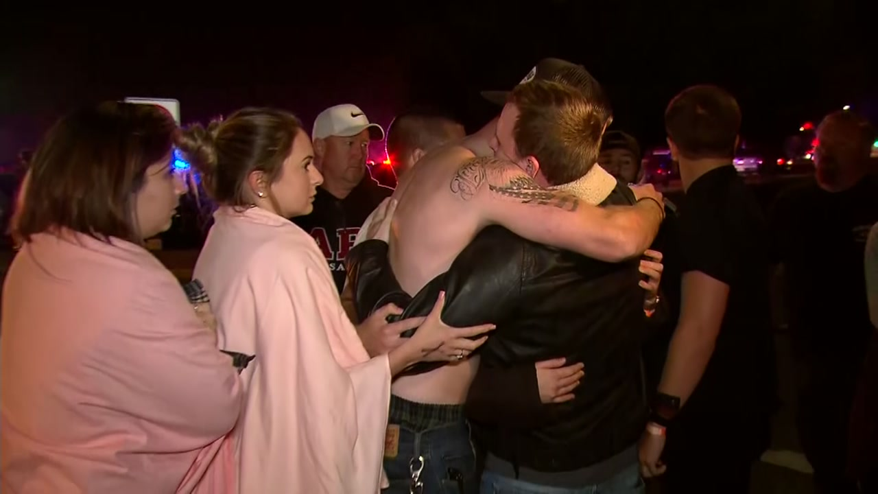 <div class='meta'><div class='origin-logo' data-origin='none'></div><span class='caption-text' data-credit='CNN'>Two men embrace after a mass shooting at California nightclub.</span></div>