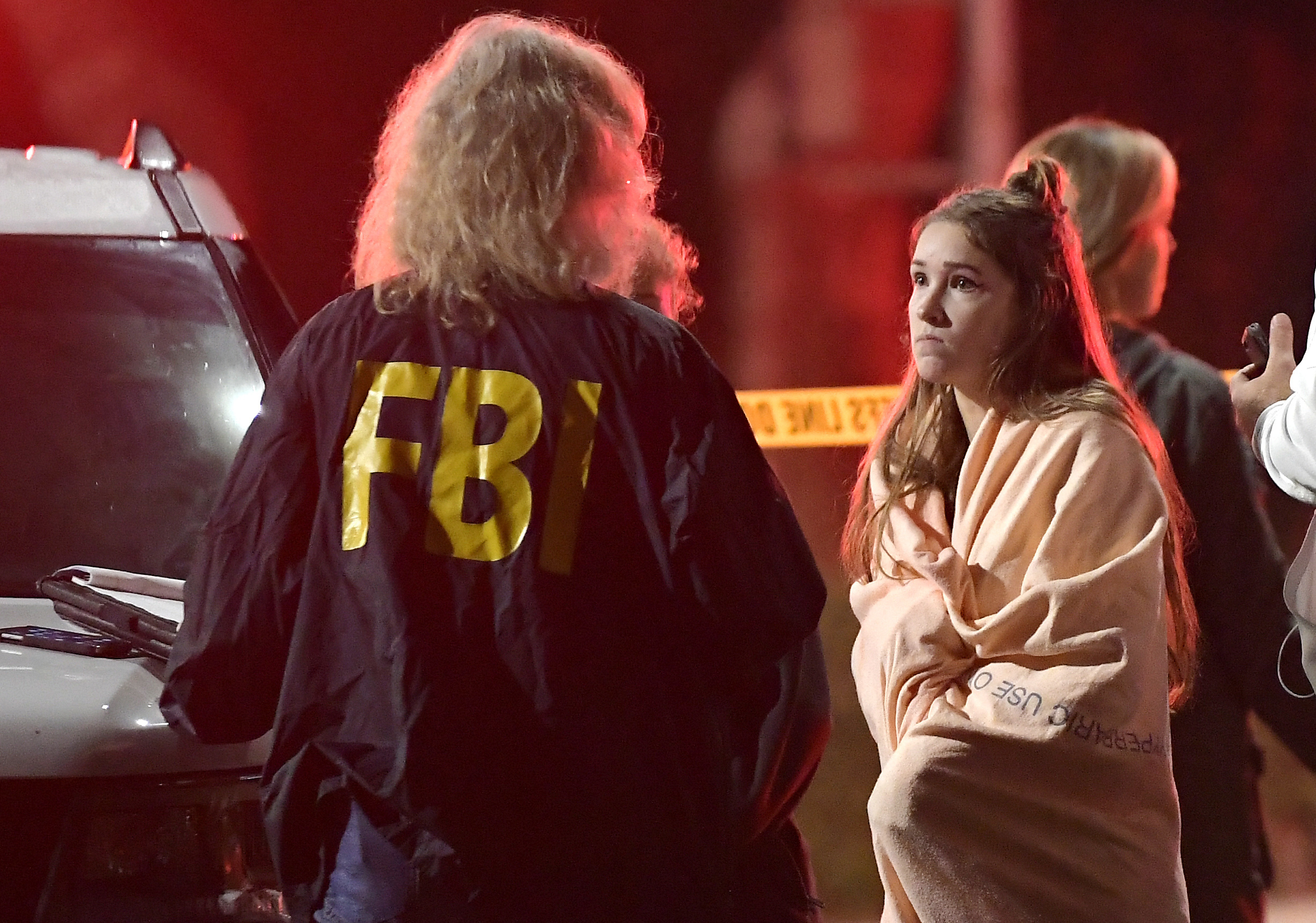 <div class='meta'><div class='origin-logo' data-origin='none'></div><span class='caption-text' data-credit='AP Photo/Mark J. Terrill'>An FBI agent talks to a potential witness at a shooting at a California nightclub.</span></div>