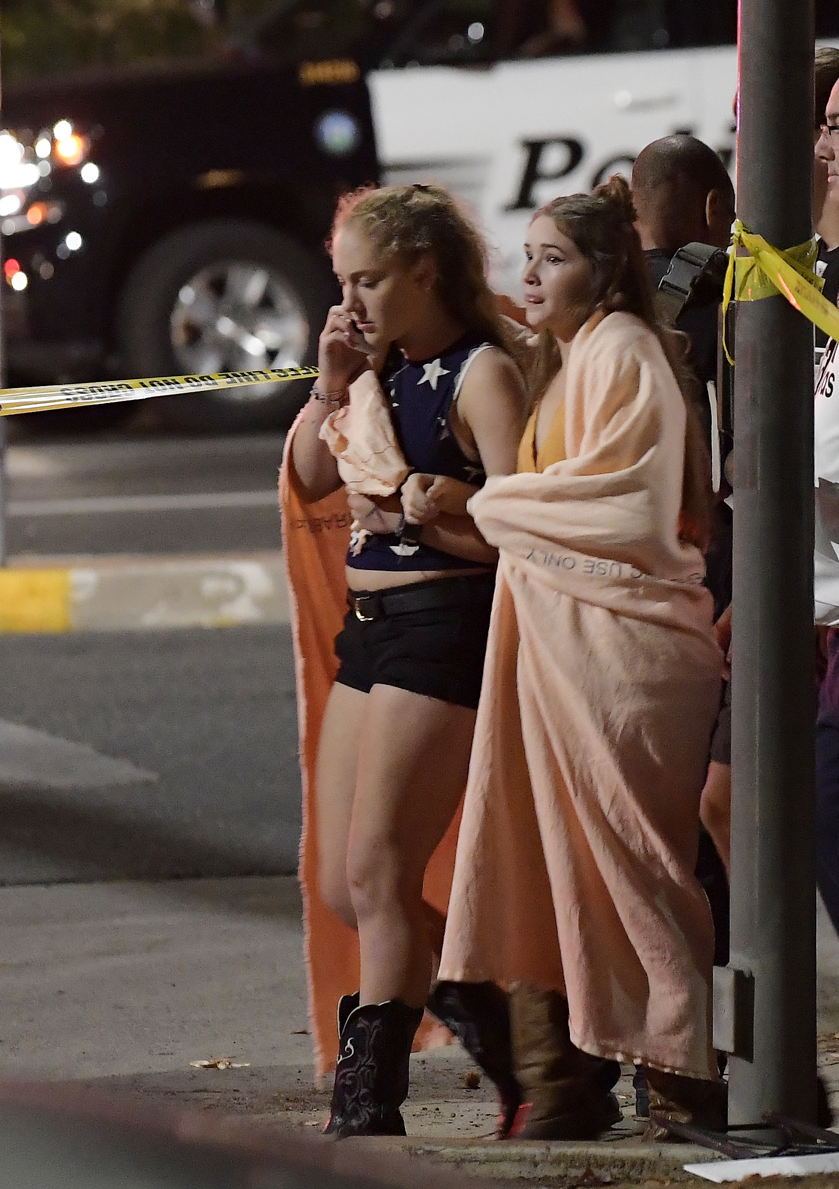 <div class='meta'><div class='origin-logo' data-origin='none'></div><span class='caption-text' data-credit='AP Photo/Mark J. Terrill'>Two young ladies comfort each other after a shooting at a California nightclub.</span></div>