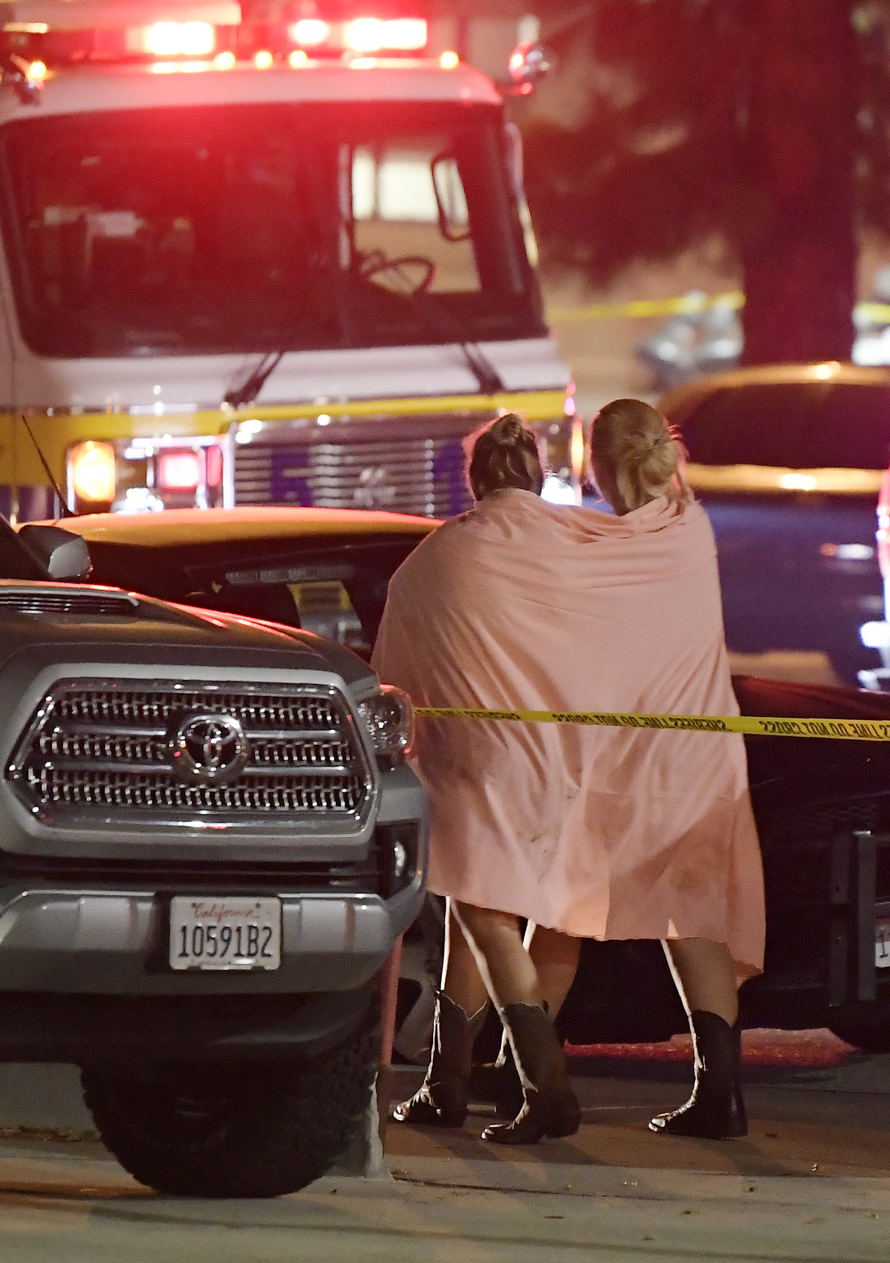 <div class='meta'><div class='origin-logo' data-origin='none'></div><span class='caption-text' data-credit='AP Photo/Mark J. Terrill'>People walk away from the scene after a gunman opens fire on a nightclub in California.</span></div>