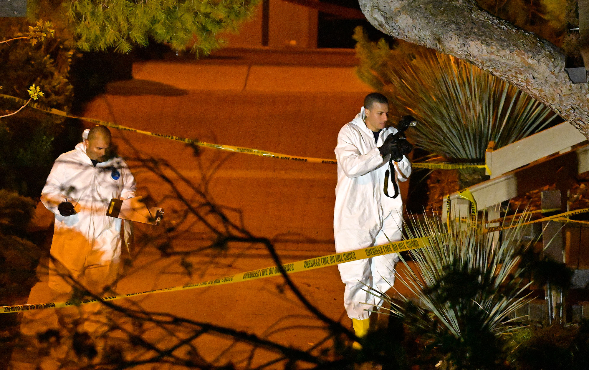 <div class='meta'><div class='origin-logo' data-origin='none'></div><span class='caption-text' data-credit='Mark J. Terrill/AP Photo'>A forensics team works the scene Thursday, Nov. 8, 2018, in Thousand Oaks, Calif.</span></div>