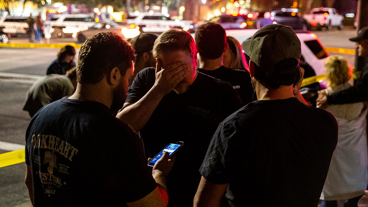 <div class='meta'><div class='origin-logo' data-origin='none'></div><span class='caption-text' data-credit='Kent Nishimura / Los Angeles Times'>People stand in a parking lot along South Moorpark Road in the aftermath of a mass shooting at Borderline Bar & Grill, on Thursday, Nov. 8, 2018.</span></div>