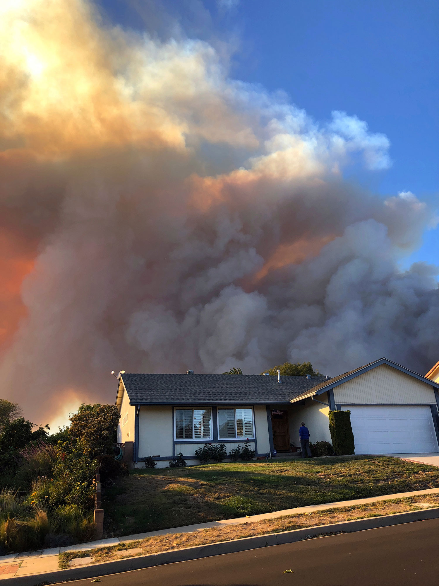<div class='meta'><div class='origin-logo' data-origin='none'></div><span class='caption-text' data-credit='Kathleen Ronayne/AP Photo'>Flames loom up several miles away, seen behind a home in Thousand Oaks, Calif., as a wind-driven wildfire known as the Hill fire threatens the area on Nov. 4.</span></div>