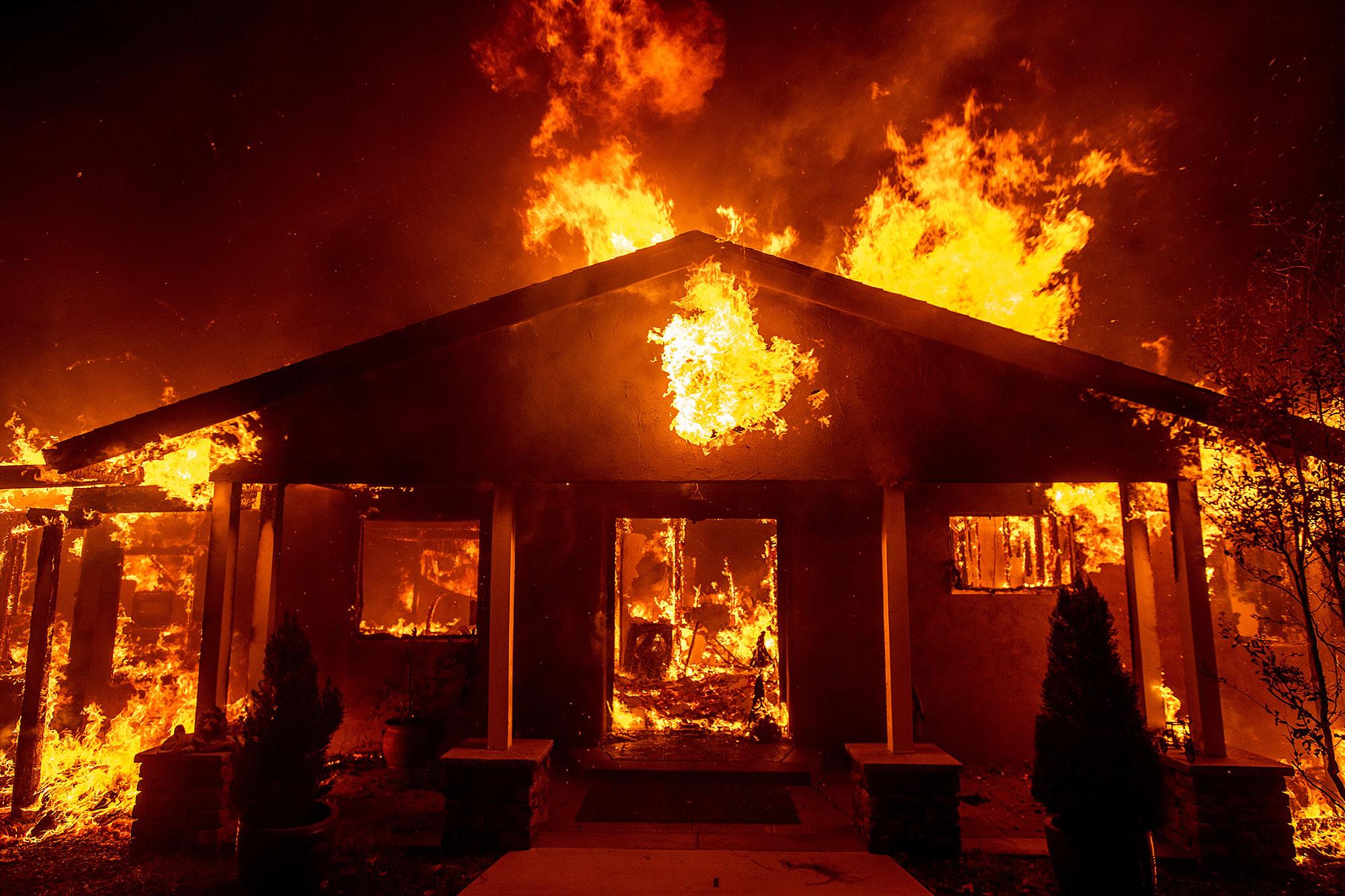 <div class='meta'><div class='origin-logo' data-origin='none'></div><span class='caption-text' data-credit='Noah Berger/AP Photo'>A home burns as the Camp Fire rages through Paradise, Calif., on Thursday, Nov. 8, 2018.</span></div>