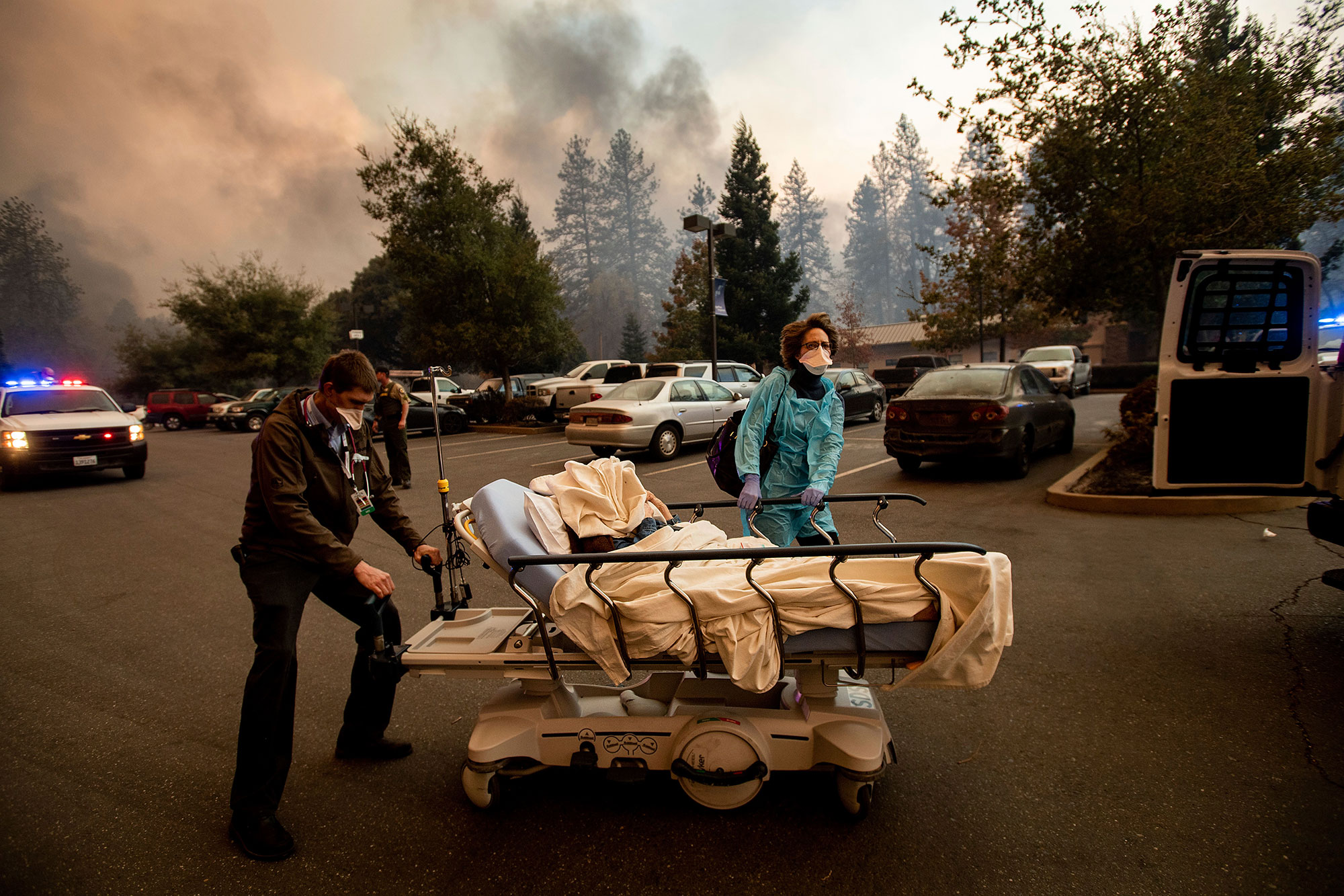 <div class='meta'><div class='origin-logo' data-origin='none'></div><span class='caption-text' data-credit='Noah Berger/AP Photo'>Medical personnel evacuate patients as the Feather River Hospital burns while the Camp Fire rages through Paradise, Calif., on Thursday, Nov. 8, 2018</span></div>