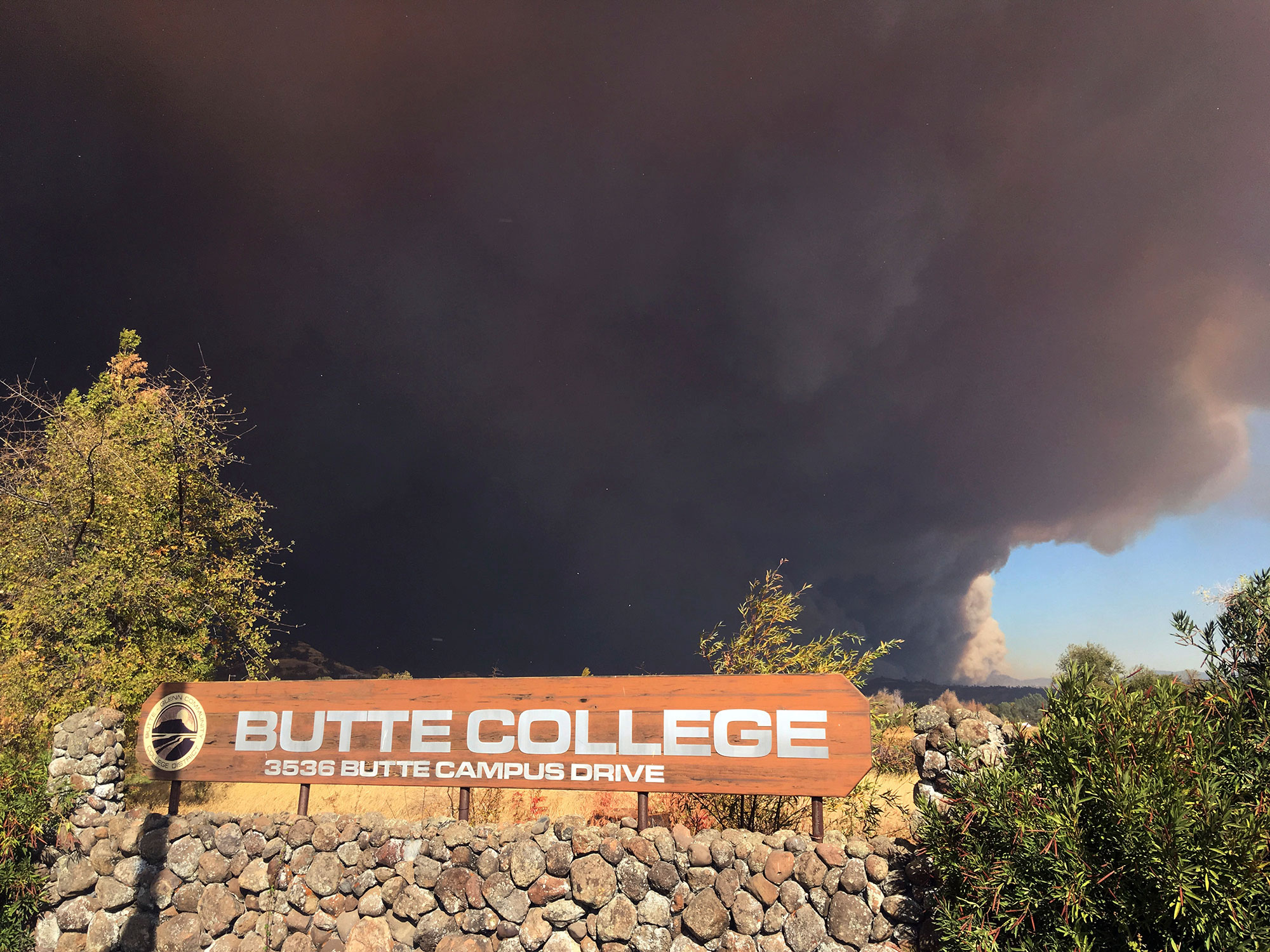 <div class='meta'><div class='origin-logo' data-origin='none'></div><span class='caption-text' data-credit='Don Thompson/AP Photo'>Smoke from the Camp Fire, burning in the Feather River Canyon near Paradise, Calif., darkens the sky above the Butte College sig in Oroville, Calif., Thursday, Nov. 8, 2018.</span></div>