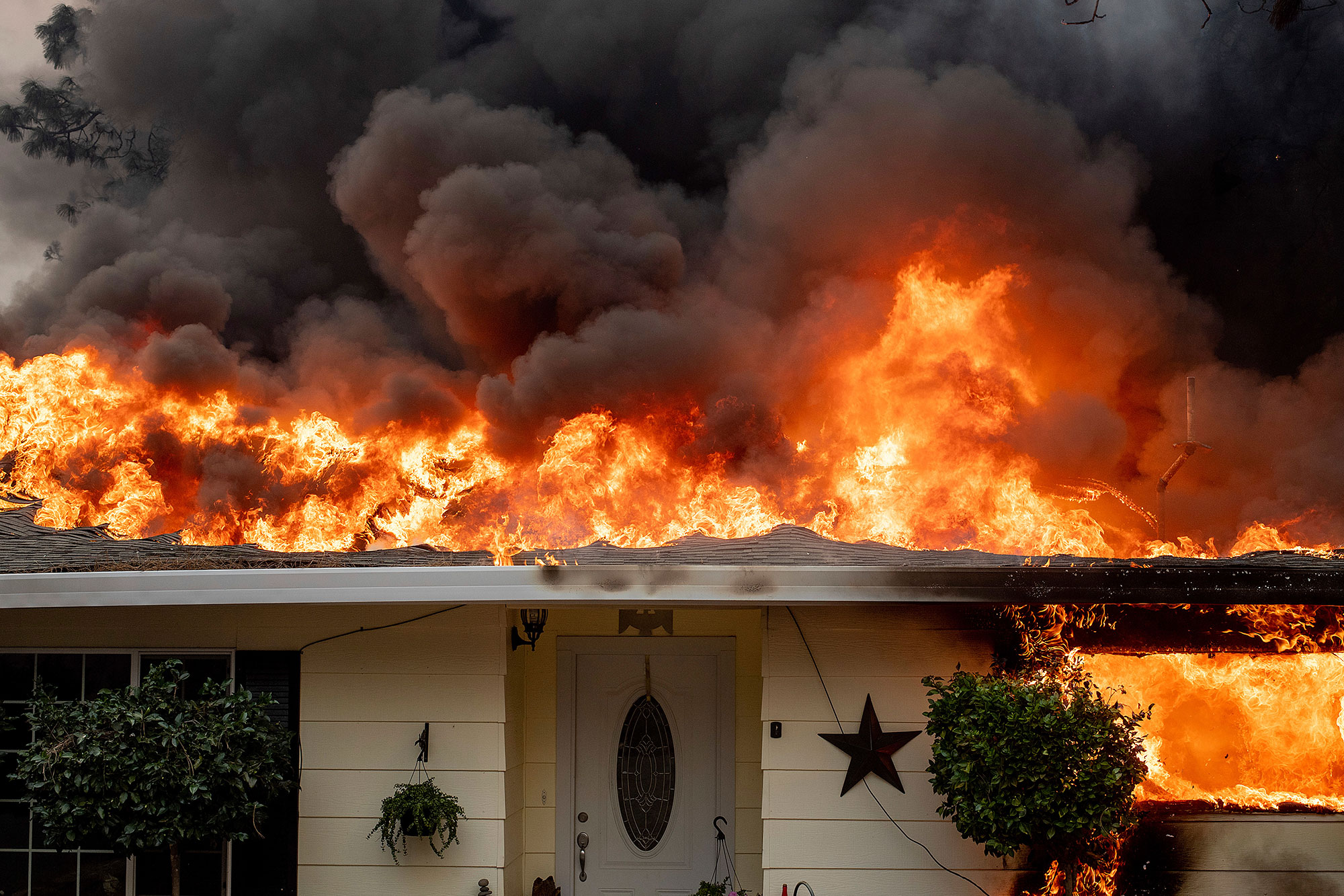 <div class='meta'><div class='origin-logo' data-origin='none'></div><span class='caption-text' data-credit='Noah Berger/AP Photo'>Flames consume a home as the Camp Fire tears through Paradise, Calif., on Thursday, Nov. 8, 2018.</span></div>