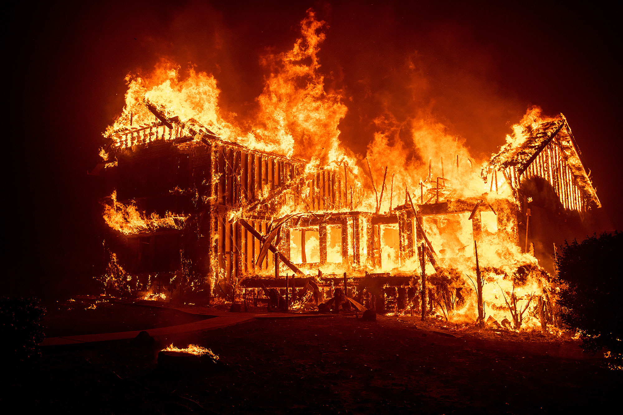 <div class='meta'><div class='origin-logo' data-origin='none'></div><span class='caption-text' data-credit='Noah Berger/AP Photo'>home burns as the Camp Fire rages through Paradise, Calif., on Thursday, Nov. 8, 2018.</span></div>