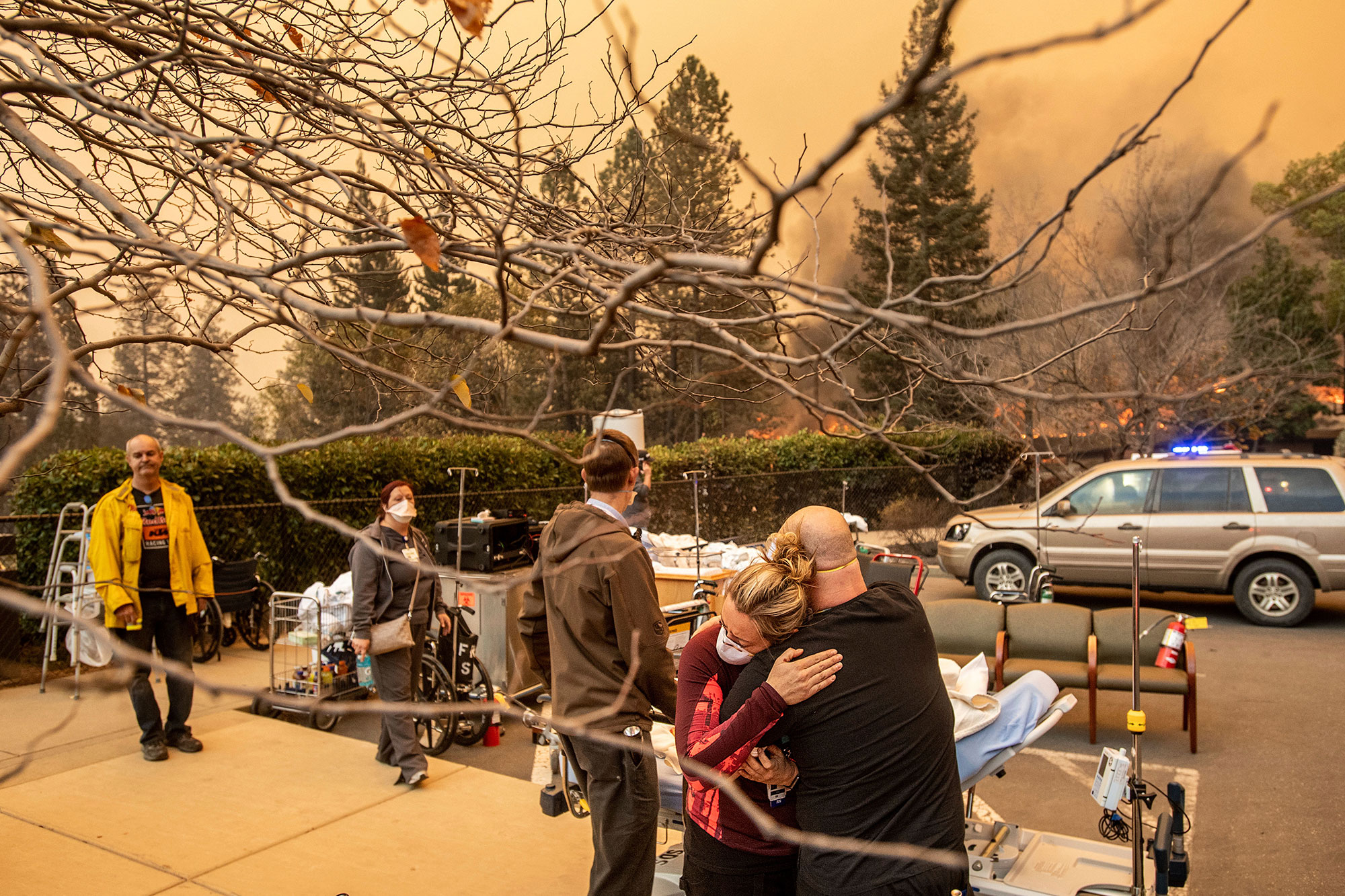 <div class='meta'><div class='origin-logo' data-origin='none'></div><span class='caption-text' data-credit='Noah Berger/AP Photo'>Nurse Cassie Lerossignol hugs as coworker as the Feather River Hospital burns while the Camp Fire rages through Paradise, Calif., on Thursday, Nov. 8, 2018.</span></div>