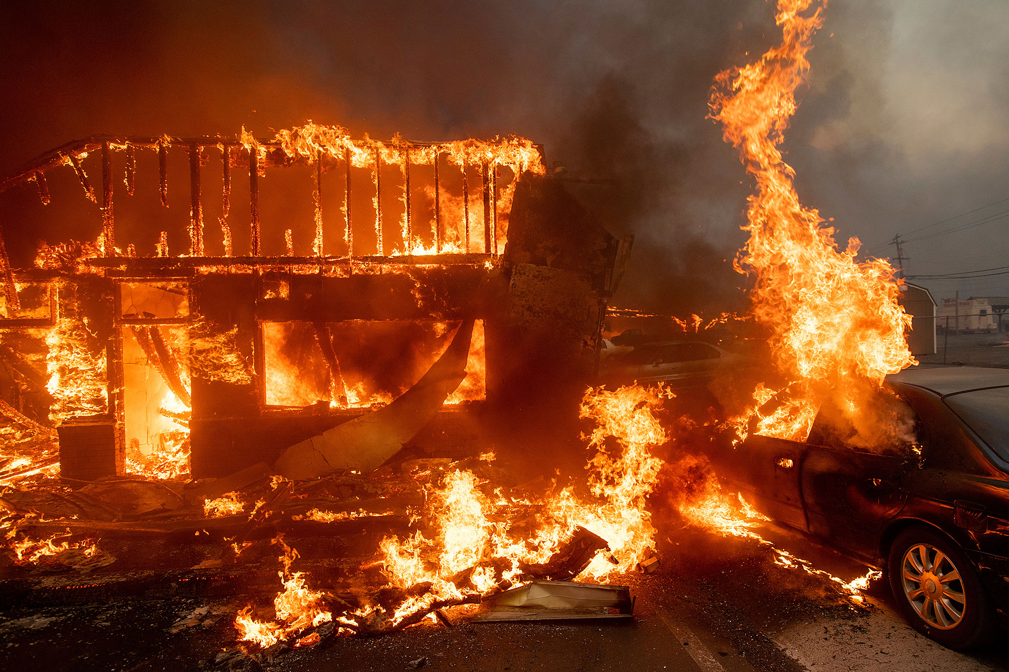 <div class='meta'><div class='origin-logo' data-origin='none'></div><span class='caption-text' data-credit='Noah Berger/AP Photo'>Flames consume a car and building as the Camp Fire tears through Paradise, Calif., on Thursday, Nov. 8, 2018.</span></div>