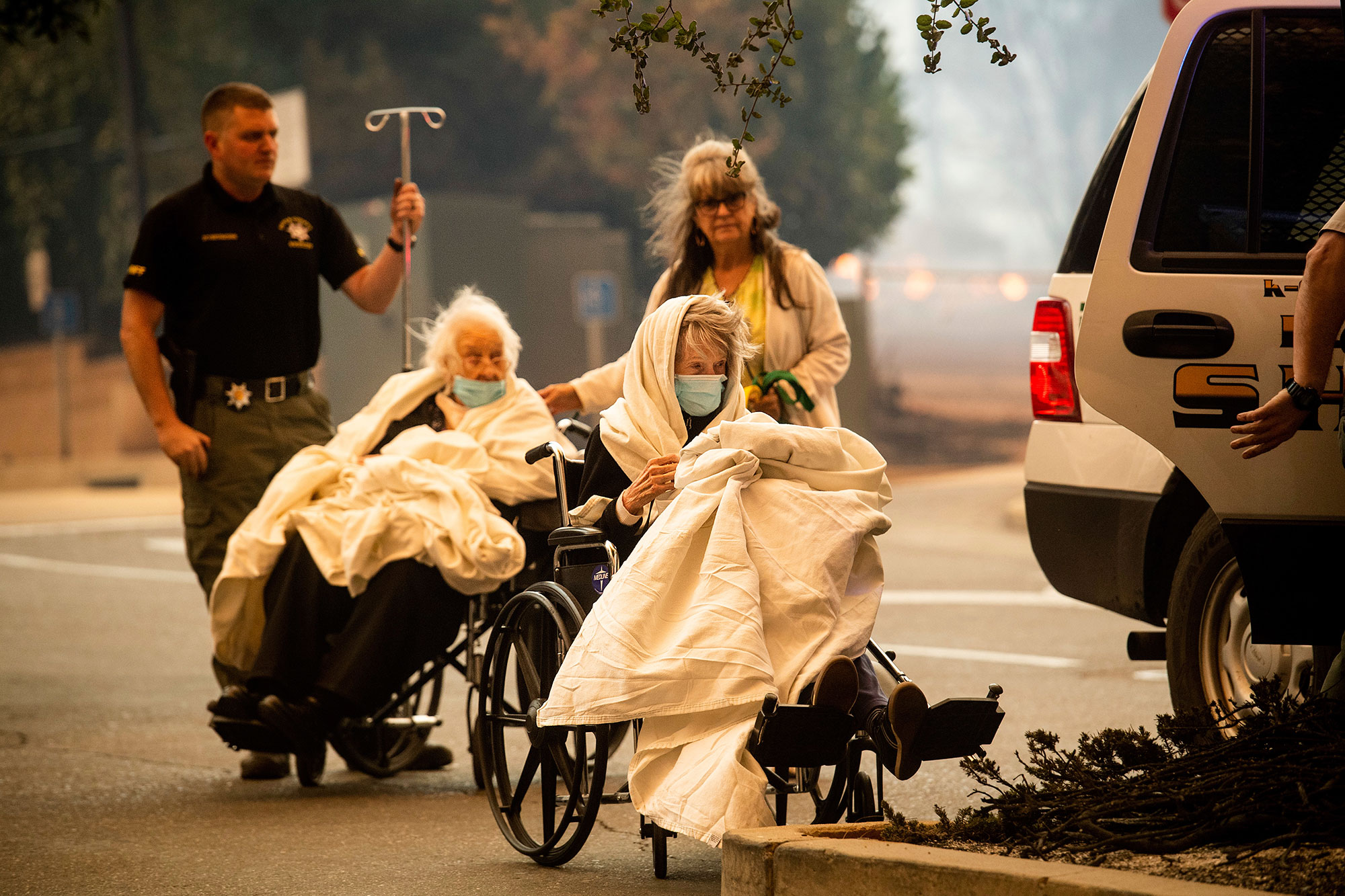 <div class='meta'><div class='origin-logo' data-origin='none'></div><span class='caption-text' data-credit='Noah Berger/AP Photo'>Emergency personnel evacuate patients as the Feather River Hospital burns while the Camp Fire rages through Paradise, Calif., on Thursday, Nov. 8, 2018.</span></div>