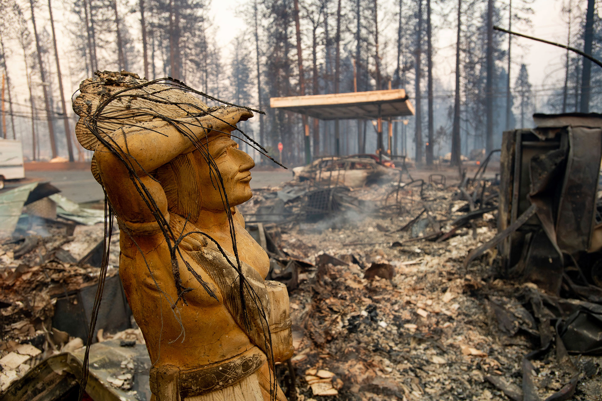 <div class='meta'><div class='origin-logo' data-origin='none'></div><span class='caption-text' data-credit='Noah Berger/AP Photo'>A statue rests amid a charred lot as the Camp Fire tears through Paradise, Calif., on Thursday, Nov. 8, 2018.</span></div>