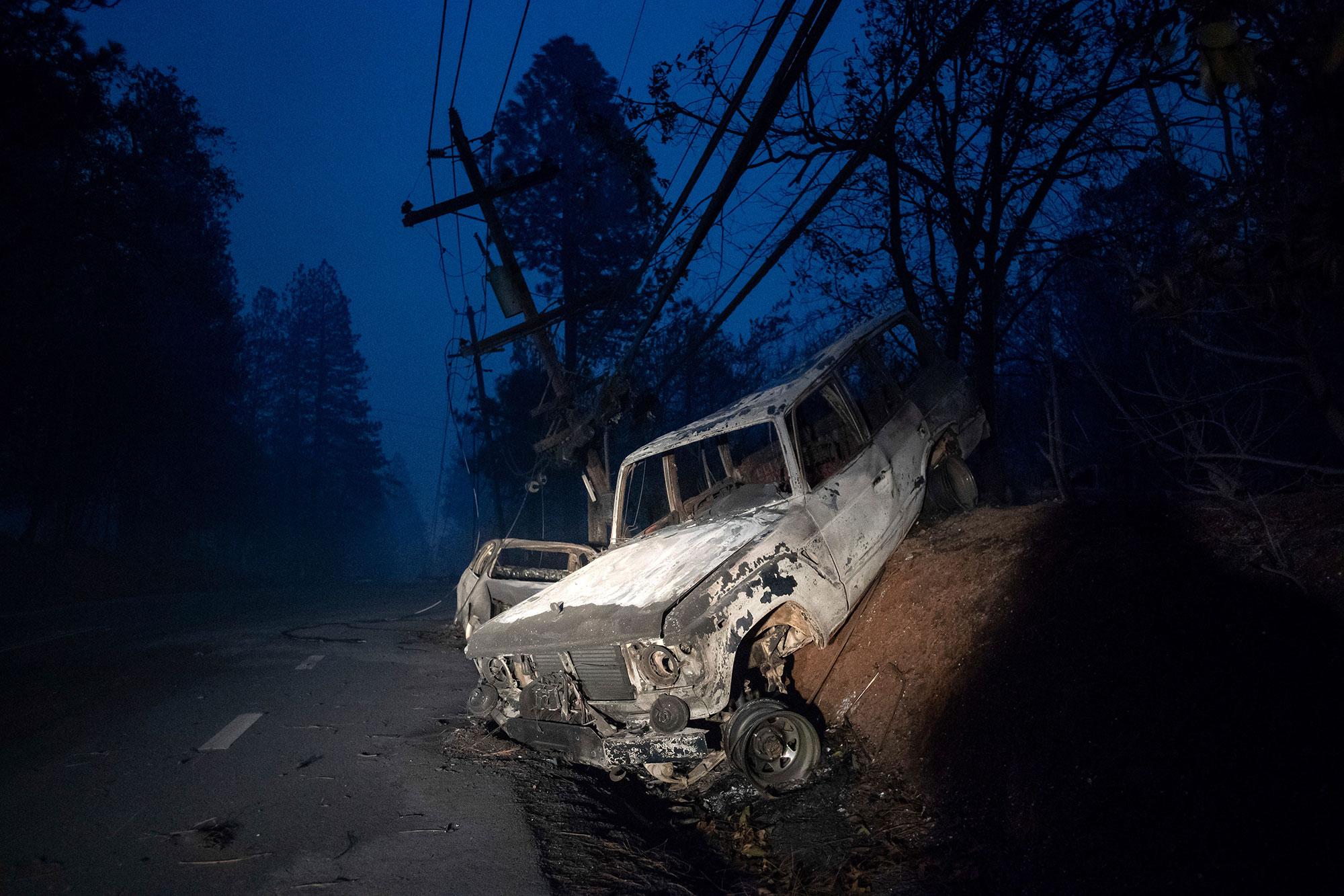 <div class='meta'><div class='origin-logo' data-origin='none'></div><span class='caption-text' data-credit='Noah Berger/AP Photo'>A scorched vehicle rests on a roadside as the Camp Fire tears through Paradise, Calif., on Thursday, Nov. 8, 2018.</span></div>