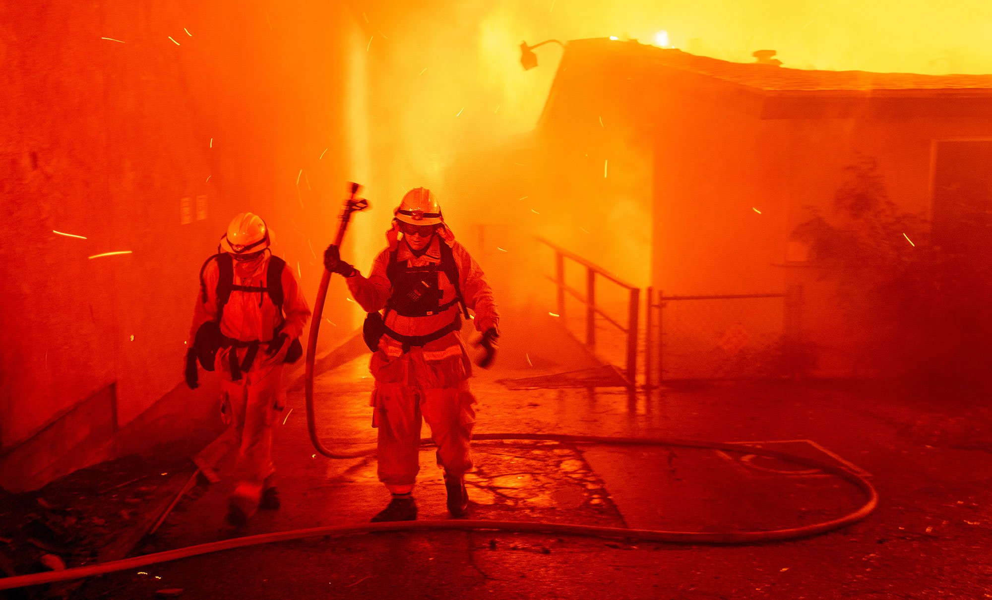 <div class='meta'><div class='origin-logo' data-origin='none'></div><span class='caption-text' data-credit='Noah Berger/AP Photo'>Firefighters battle the Camp Fire as it tears through Paradise, Calif., on Thursday, Nov. 8, 2018.</span></div>