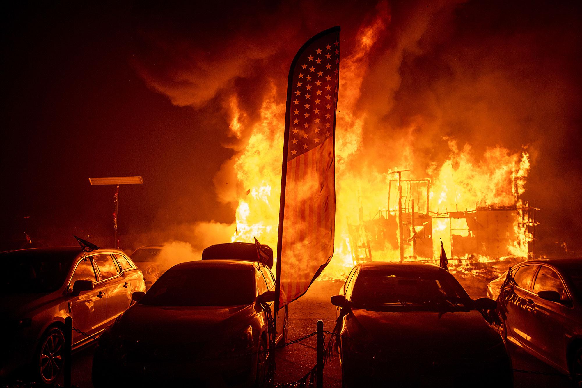 <div class='meta'><div class='origin-logo' data-origin='none'></div><span class='caption-text' data-credit='Noah Berger/AP Photo'>Flames consume a car dealership as the Camp Fire tears through Paradise, Calif., on Thursday, Nov. 8, 2018.</span></div>
