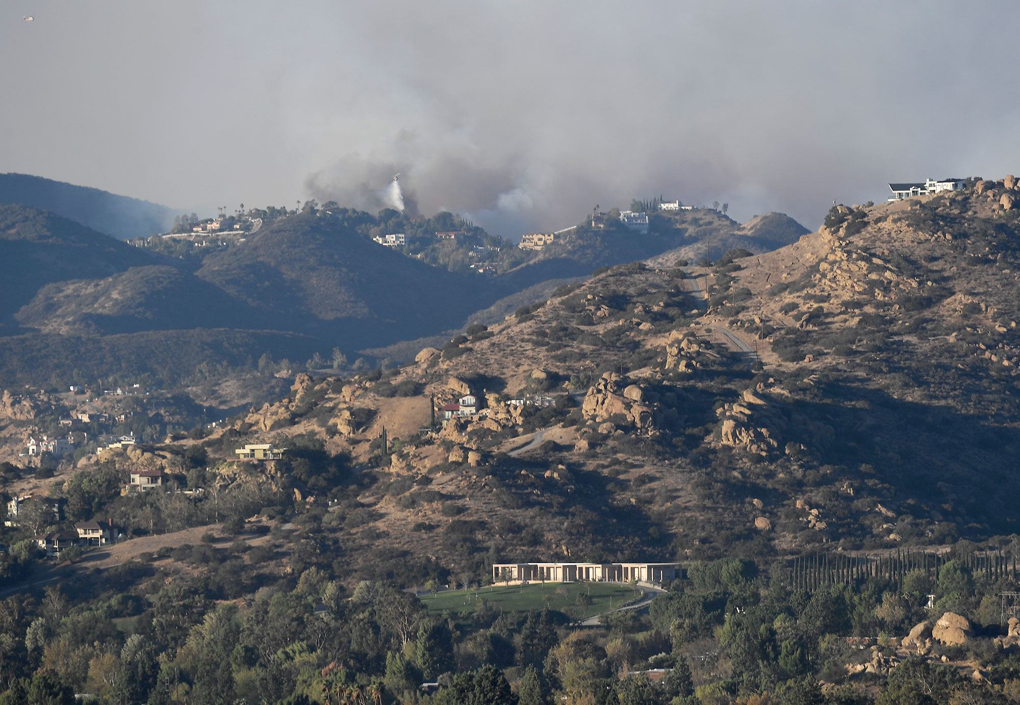 <div class='meta'><div class='origin-logo' data-origin='none'></div><span class='caption-text' data-credit='Kevork Djansezian/Getty Images'>The Woolsey Fire is seen looking towards the Oak Park area on November 9, 2018 in Porter Ranch, California.</span></div>