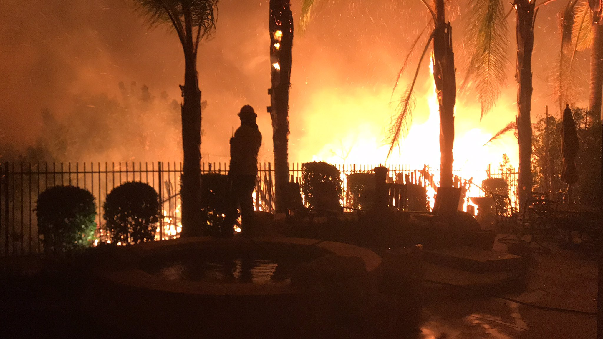 <div class='meta'><div class='origin-logo' data-origin='none'></div><span class='caption-text' data-credit=''>The Los Angeles County Fire Department shared this image of a firefighter battling the flames on Friday.</span></div>