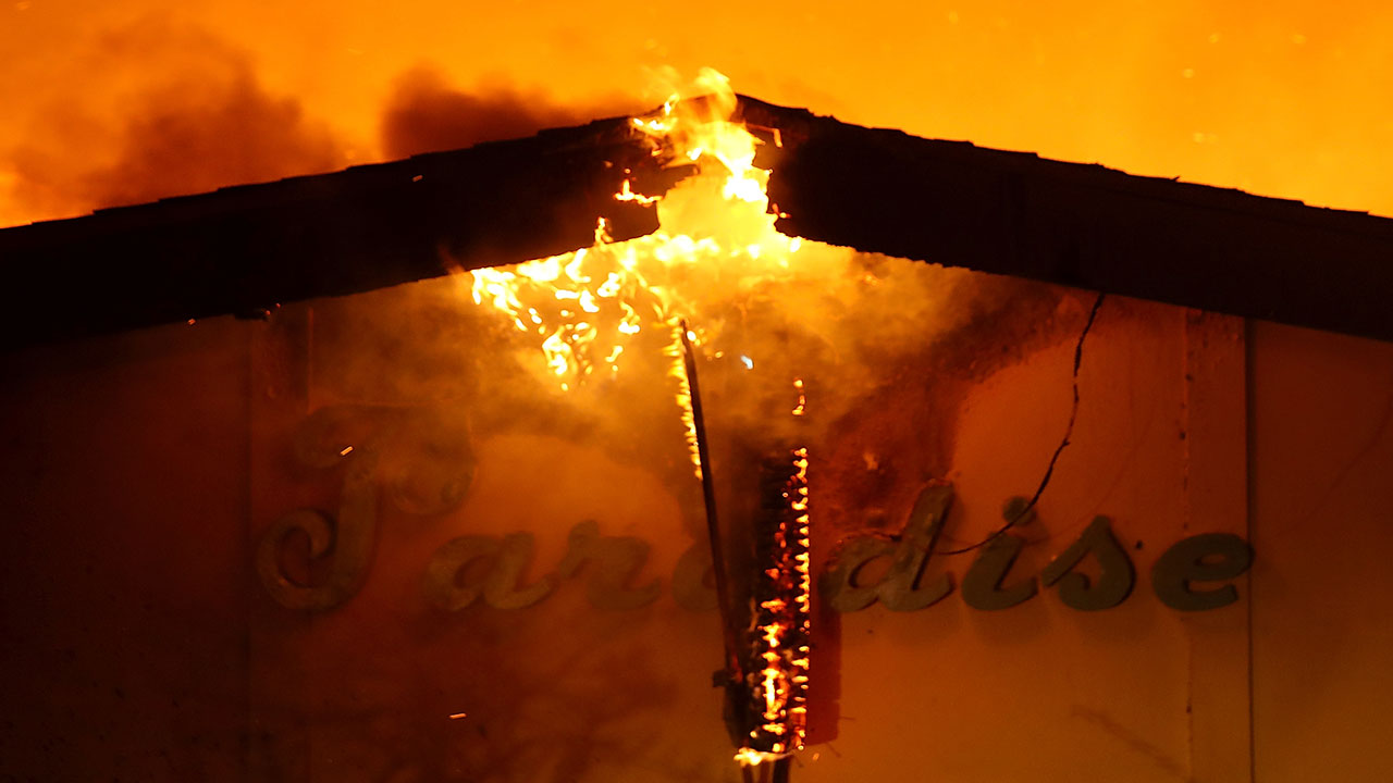 <div class='meta'><div class='origin-logo' data-origin='none'></div><span class='caption-text' data-credit='Justin Sullivan/Getty Images'>A sign is posted on the Paradise Skilled Nursing center as it is consumed by flames from the Camp Fire on November 8, 2018 in Paradise, California.</span></div>