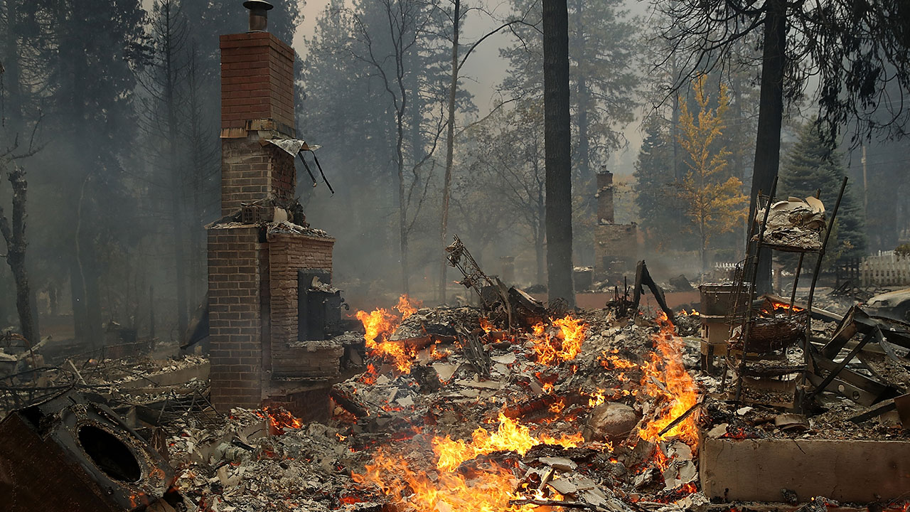 <div class='meta'><div class='origin-logo' data-origin='none'></div><span class='caption-text' data-credit='Justin Sullivan/Getty Images'>A chimney remains at the site of a home that burned as the Camp Fire moves through the area on November 8, 2018 in Paradise, California</span></div>