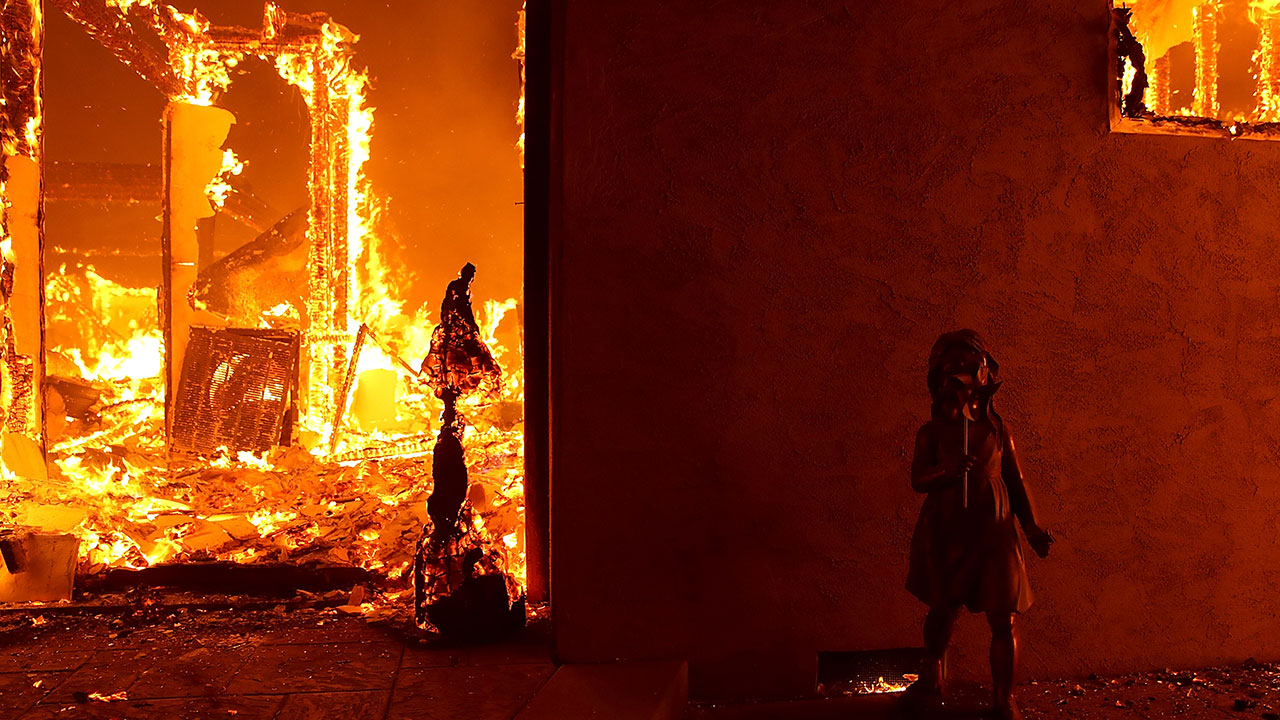 <div class='meta'><div class='origin-logo' data-origin='none'></div><span class='caption-text' data-credit='Justin Sullivan/Getty Images'>A home burns as the Camp Fire moves through the area on November 8, 2018 in Paradise, California.</span></div>
