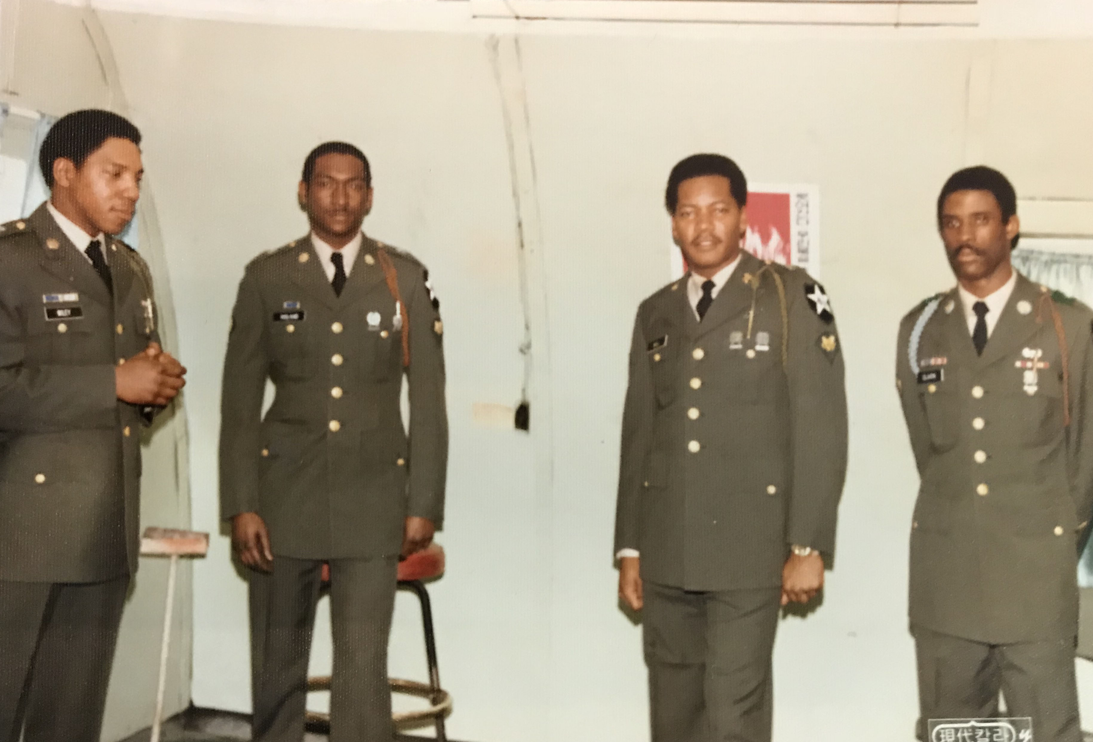 "<div class=""meta image-caption""><div class=""origin-logo origin-image none""><span>none</span></div><span class=""caption-text"">Kenneth Bell with fellow servicemen at a promotion ceremony (Kenneth Bell)</span></div>"