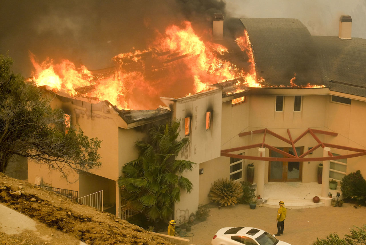 <div class='meta'><div class='origin-logo' data-origin='AP'></div><span class='caption-text' data-credit='AP Photo/Ringo H.W. Chiu'>The Woolsey fire burns a home near Malibu Lake in Malibu, Calif., Friday, Nov. 9, 2018.</span></div>