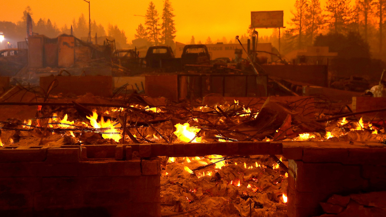 <div class='meta'><div class='origin-logo' data-origin='Creative Content'></div><span class='caption-text' data-credit='Justin Sullivan/Getty Images'>A business that was destroyed by the Camp Fire continues to smolder on November 9, 2018, in Paradise, California.</span></div>