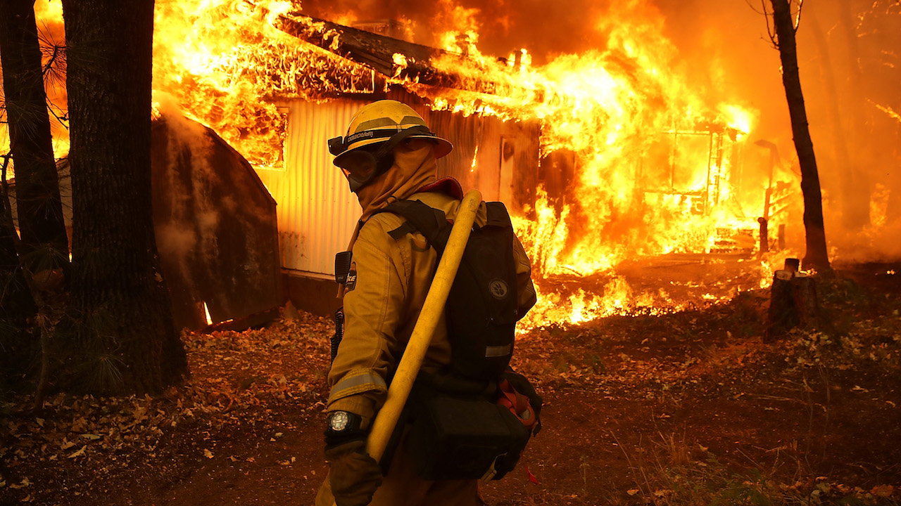 <div class='meta'><div class='origin-logo' data-origin='Creative Content'></div><span class='caption-text' data-credit='Justin Sullivan/Getty Images'>A Cal Fire firefighter monitors a burning home as the Camp Fire moves through the area on November 9, 2018, in Magalia, California.</span></div>