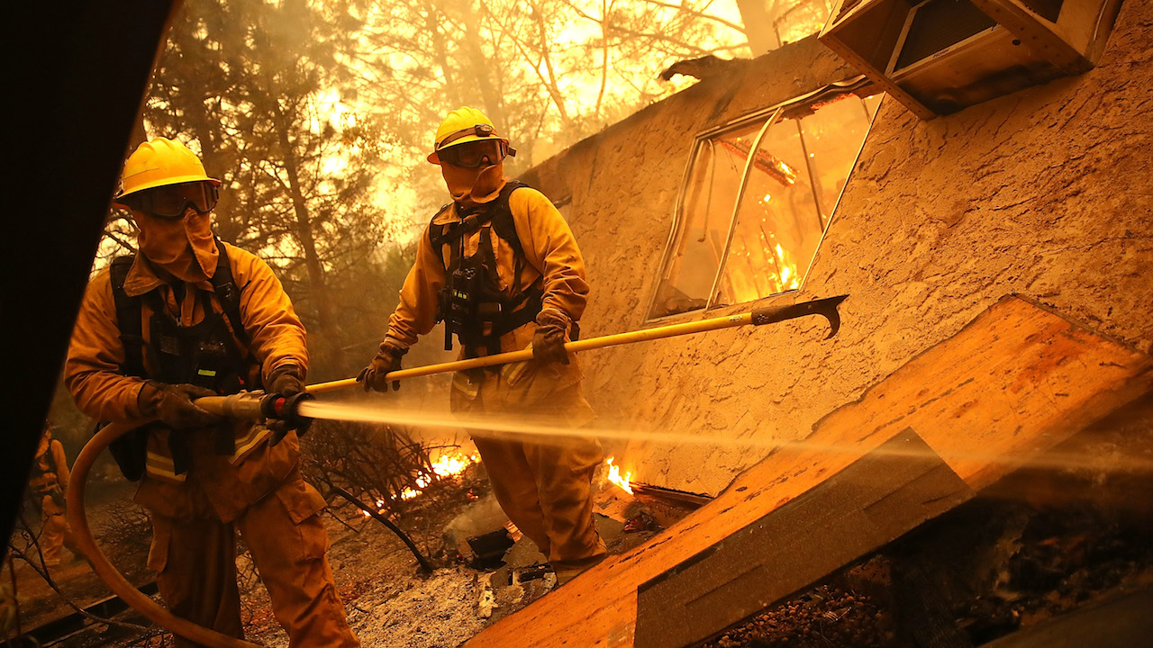 <div class='meta'><div class='origin-logo' data-origin='Creative Content'></div><span class='caption-text' data-credit='Justin Sullivan/Getty Images'>Firefighters try to keep flames from burning home from spreading to a neighboring apartment complex as they battle the Camp Fire on November 9, 2018, in Paradise, California.</span></div>