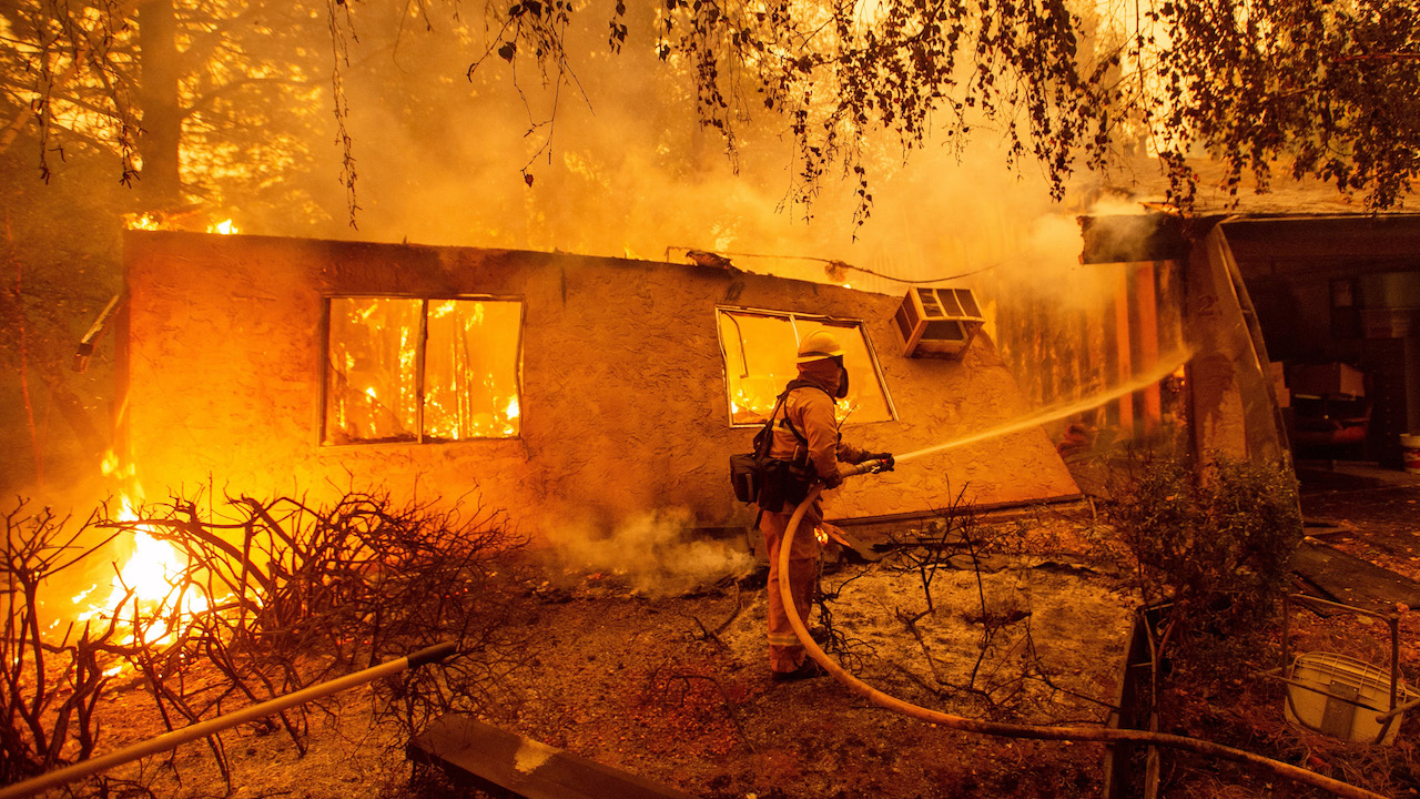 <div class='meta'><div class='origin-logo' data-origin='Creative Content'></div><span class='caption-text' data-credit='Josh Edelson/AFP/Getty Images'>Firefighters battle flames at a burning apartment complex in Paradise, north of Sacramento, California on November 09, 2018.</span></div>