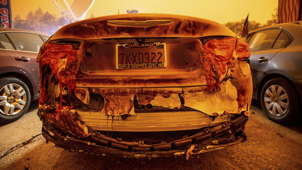 <div class='meta'><div class='origin-logo' data-origin='AP'></div><span class='caption-text' data-credit='AP Photo/Noah Berger'>A scorched vehicle sits parked at a used car dealership after a wildfire burned through Paradise, Calif., on Friday, Nov. 9, 2018.</span></div>