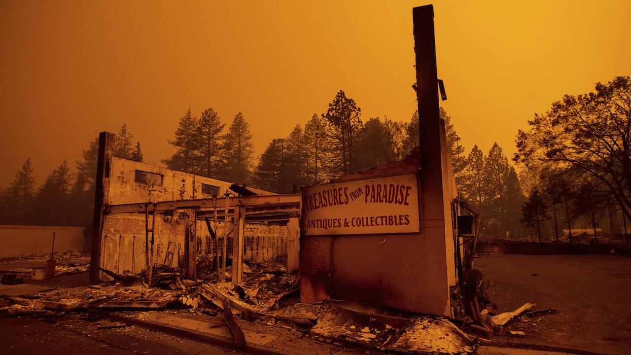 <div class='meta'><div class='origin-logo' data-origin='AP'></div><span class='caption-text' data-credit='AP Photo/Noah Berger'>The walls of a scorched antique shop stand on Skyway after a wildfire burned through Paradise, Calif., on Friday, Nov. 9, 2018.</span></div>