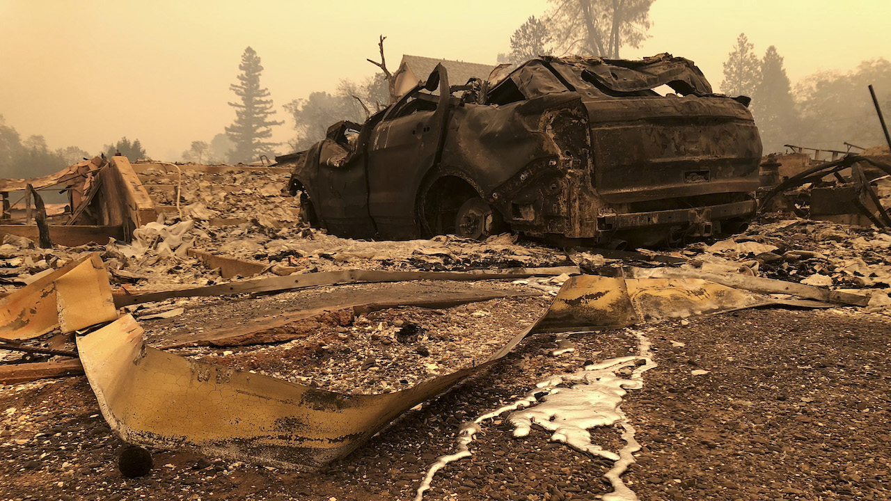 <div class='meta'><div class='origin-logo' data-origin='AP'></div><span class='caption-text' data-credit='AP Photo/Gillian Flaccus'>A burned out car sits on the side of the road in Paradise, Calif., Friday, Nov. 9, 2018, after a wildfire swept through the area.</span></div>