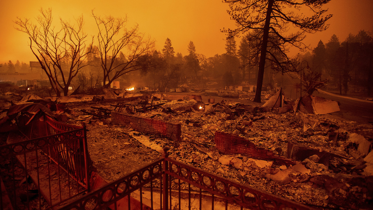 <div class='meta'><div class='origin-logo' data-origin='AP'></div><span class='caption-text' data-credit='AP Photo/Noah Berger'>Rubble lines a lot on Skyway after a wildfire burned through Paradise, Calif., on Friday, Nov. 9, 2018.</span></div>