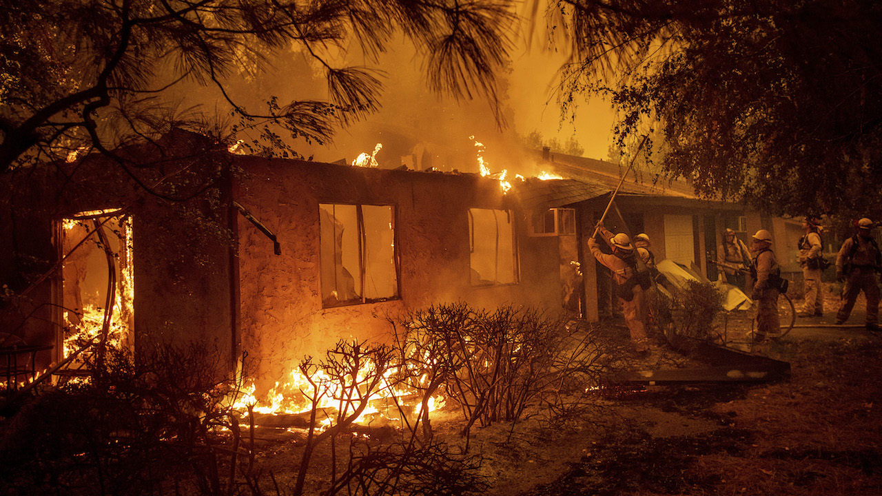 <div class='meta'><div class='origin-logo' data-origin='AP'></div><span class='caption-text' data-credit='APAP Photo/Noah Berger'>Firefighters work to keep flames from spreading through the Shadowbrook apartment complex as a wildfire burns through Paradise, Calif., on Friday, Nov. 9, 2018.</span></div>