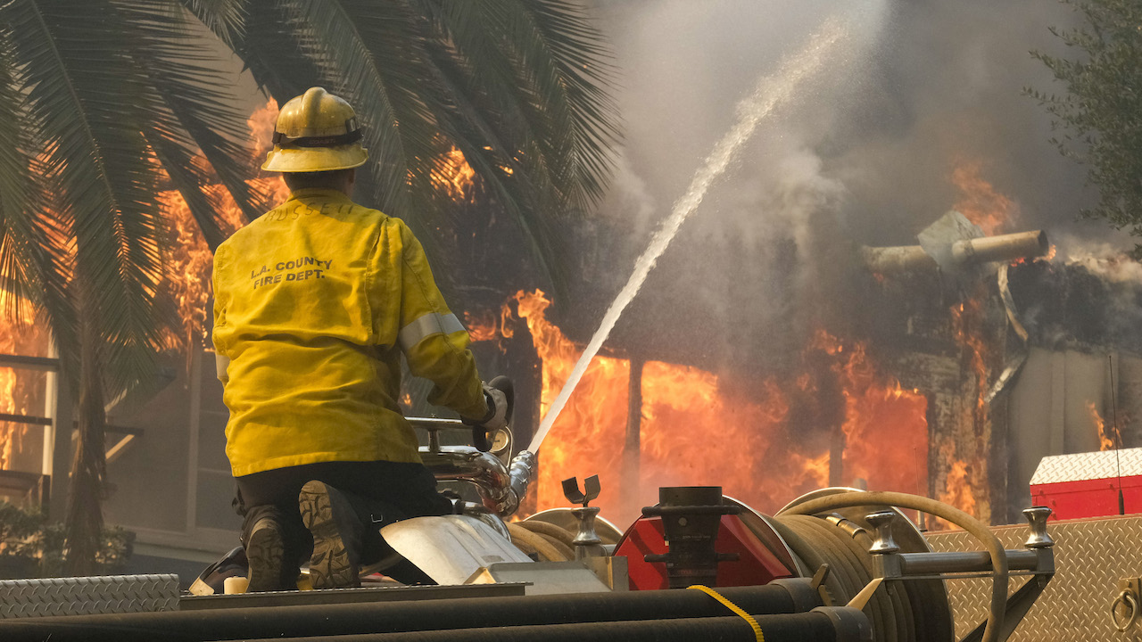 <div class='meta'><div class='origin-logo' data-origin='AP'></div><span class='caption-text' data-credit='AP Photo/Ringo H.W. Chiu'>A firefighter sprays water on a burning home during the Woolsey fire in Malibu, Calif., Friday, Nov. 9, 2018.</span></div>