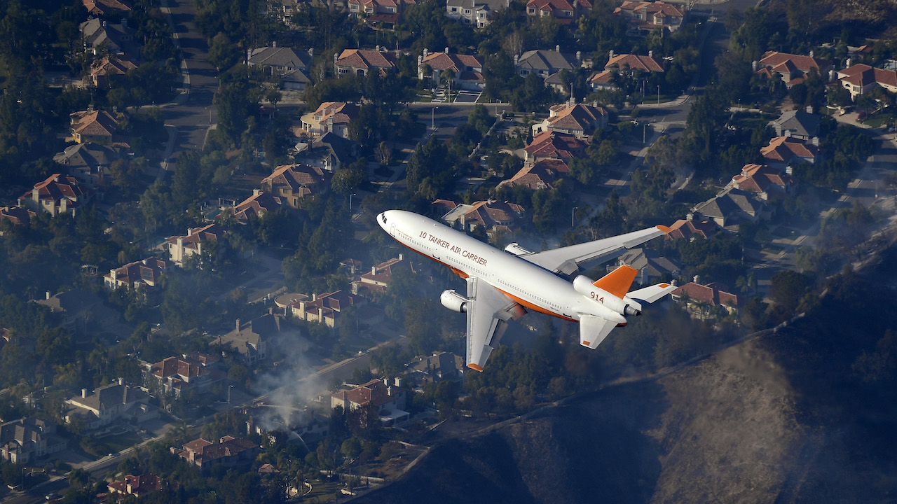 <div class='meta'><div class='origin-logo' data-origin='AP'></div><span class='caption-text' data-credit='AP Photo/Mark J. Terrill'>A DC-10 air tanker flies over homes as fires burn Friday, Nov. 9, 2018, as seen from a helicopter over the Calabasas section of Los Angeles.</span></div>