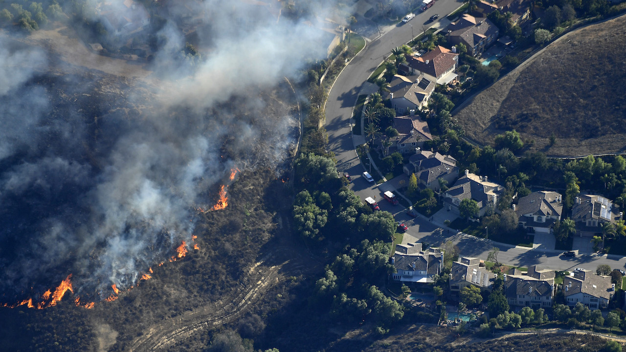 <div class='meta'><div class='origin-logo' data-origin='AP'></div><span class='caption-text' data-credit='AP Photo/Mark J. Terrill'>Fires burn toward homes Friday, Nov. 9, 2018, as seen from a helicopter over the Calabasas section of Los Angeles.</span></div>