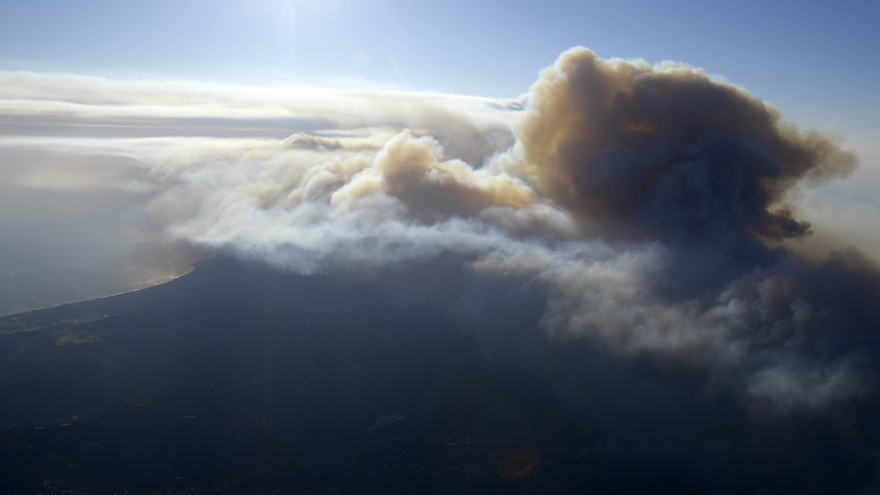 <div class='meta'><div class='origin-logo' data-origin='AP'></div><span class='caption-text' data-credit='AP Photo/Mark J. Terrill'>Fires burn toward the ocean as seen Friday, Nov. 9, 2018, from a helicopter over the Topanga section of Los Angeles.</span></div>